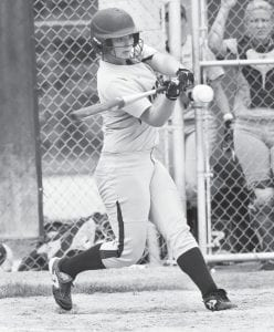 Blue Streak senior Cassi Wyse belts a home run with two outs in the sixth inning to give AHS a 2-1 lead that held up, giving Archbold a district championship, Saturday, May 21.– photo by Mary Huber
