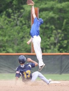 Nic Rodriguez steals second as the ball sails over the Elmwood second baseman's head in the seventh inning of their regional semifinal.