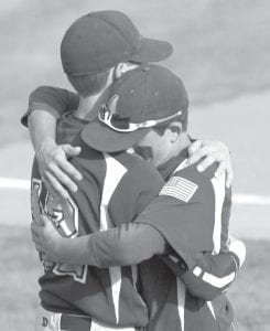 Senior Derek Walker (12) consoles Bryce Williams after the Streaks fell in the regional final.– photo by Mary Huber