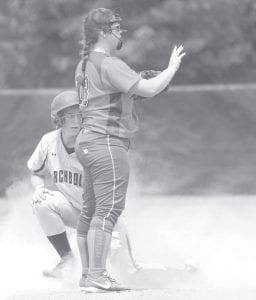 Left: Andi Peterson is safe at third base after hitting a triple in the third inning of Archbold's regional final with Edison, Saturday, May 28, at Bellefontaine. The Streaks were unable to