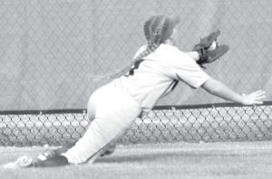 Brooke Hines makes a diving catch in center field in the fifth inning of Archbold's regional semifinal with Paulding.– photo by Mary Huber