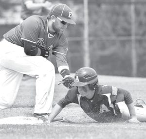Toby Walker is safe on the throw to first base from Elmwood's pitcher.– photo by Mary Huber