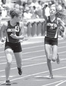 Emily Roth waits for the handoff of the baton from Julia Lambert in the 4x400.– photo by Mary Huber