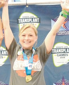 With a gold medal around her neck, Tonya Gomez raises her arms in victory. She won two gold medals at the 2016 Transplant Games of America.– courtesy photo