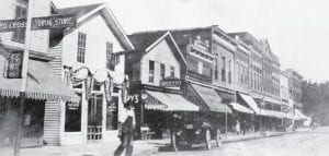 This photo of the west side of North Defiance Street was taken in the early 1900s. The street was original mud, the curbs were cut stone, and the sidewalks were cut slabs of sandstone that were in place until after World War II. The third building from left is the current site of the Archbold Buckeye. The next building was the site of the first Lauber Clothing.