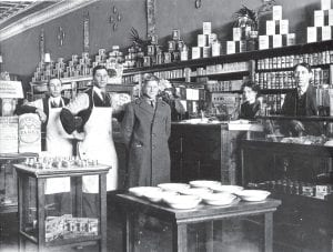 Hub Grocery The interior of the Hub Grocery, first started by Henry S. Winzeler, who founded the Ohio Art Co., in Archbold in 1908. He moved the company to Bryan in the fall of 1912. The grocery was in the south room of the Peoples State Bank Co., on the west side of North Defiance Street, which is now the Child's Investment Group building. It was Archbold's first real grocery store. From left: Howard T. Schaff, co-owner, formerly of Bryan; Olley Bourquin, clerk; Ora Nofziger, clerk; Myrtle Claire, cashier; and John P. Rinkel, formerly of Bryan, co-owner. They delivered groceries six days a week from a horse-drawn wagon.