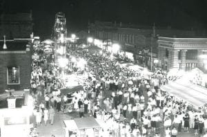 When night fell on the village, the Archbold Homecoming drew visitors to the cheery sounds of the midway. The merry-go-round was in front of the Town & Township Hall, the ferris wheel was in front of the Archbold Buckeye, and the dance hall was on Stryker Street beside the Vernier, McLaughlin, Probeck Hardware Store.