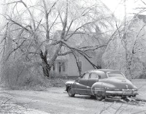 Ice storms were a common winter experience in the village in the 1940s, and the children had fun ice-skating on sidewalks and roads. Tree limbs and everything outside were coated in ice. Cracking limbs and branches were heard everywhere. W.O. Taylor's 1940 Buick Roadmaster stands in front of the Don Parlette house on North Defiance Street, where his daughter, Valetta, was visiting Mr. Parlette. Later they became husband and wife.