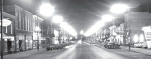 With the photographer standing on the New York Central railroad crossing, this is how North Defiance Street blazed when newly installed streetlights were turned on for the first time. Residents called it The Great White Way. It seemed blinding to the eyes.