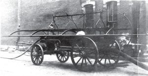 "This is ""Old Phoenix,"" the hand-operated fire pump which was purchased for $150 as a used piece of equipment from the city of Toledo in the 1870s, when Toledo adopted new horse-drawn steamer pumpers. It failed when valves stuck on Saturday, Sept. 30, 1913, when parked on the north side of West Holland Street, near the rear of what used to be the City Drug Store building and is now Carol Ann's City Cafe."