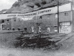 Sauder Woodworking Company yielded to the heat of rolling flames in November 1945.