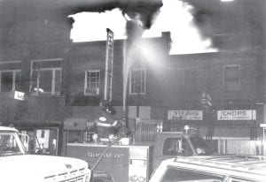 Cold weather hampered the efforts of firefighters battling the Scott Theatre on Feb. 23, 1972. Fire hoses froze, and the alley behind the buildings on the east side of the street had a coating of ice. The loss was around $100,000, and 50 firemen and 11 pieces of equipment battled the flaze.
