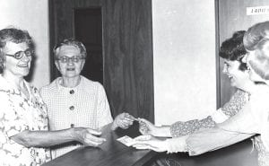 The first customers to tour Sauder Museum, Farm & Craft Village at 9:30 opening day, Monday, June 14, 1976, were two neighbors, Misses Viola and Wilma Rupp, whose farm adjoins the museum, according to a photograph from the Archbold Buckeye archives. Presenting them the first two tickets sold were Mrs. John Wilson and Mrs. Jan Schmucker.