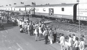 Crowds line up in the bright June sun to visit the American Freedom Train on its historic visit to Archbold.