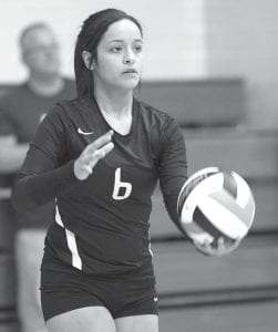 Blackbird senior Ezzie Hernandez goes back to serve in the Div. IV district semifinal against Antwerp.– photo by Mary Huber