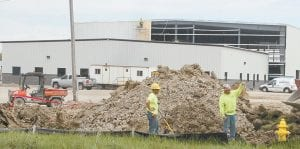 Workers at the Miller Bros. Construction shop building, located on St. Rt. 66 in Henry County just south of the Fulton-Henry county line, were busy yesterday, Tuesday. The almost- 40,000-square-foot building is to be completed in August or September. The cost is estimated at more than $5 million.– photo by David Pugh