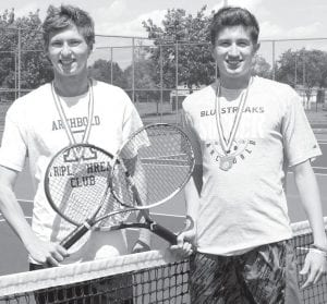 Luke McQuade, left, and Jereme Rupp are the first boys doubles players in AHS history to advance to the state tournament.– photo by Mary Huber