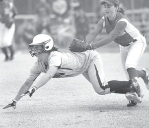 After driving in a run, Faith Wyse gets tagged between first and second base by Eastwood's Hannah Owens in their district final. Wyse was hurt on the play when Owens' leg got tangled in Wyse's and Owens rolled on Wyse's leg.– photo by Mary Huber