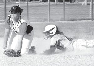 Gabby Nafziger steals second in Archbold's district semifinal with Otsego.– photo by Mario Gomez