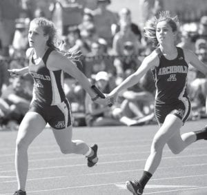Top left: Emily Roth gets the handoff from Shylo Richardson in the girls 4x100-meter race. The Streaks finished fourth in the event. Top right: Julia Lambert jumps off the block in the girls 4x400, where AHS finished fourth. Bottom left: Sam Petersen takes the handoff from Noah Blankenship in the boys 4x400. Archbold finished third. Bottom right: The Pettisville girls 4x800 team of Alexa Leppelmeier, Nichole Foor, Morgan Leppelmeier, and Elizabeth Sauder have a group prayer after the race. They finished second.– photos by Mary Huber and Beth Foor