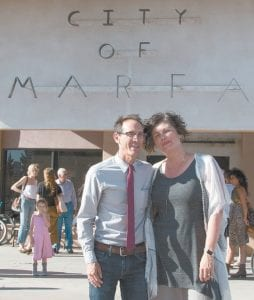 Ann Marie Nafziger, an Archbold graduate, accomplished artist, and now the mayor of the city of Marfa, Texas, with her husband, Peter Stanley, in front of the Marfa town hall. She handily won a three-way race for the post on May 6.– courtesy photo