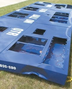 The damage to a section of the new AHS football scoreboard is shown. The scoreboard was sitting upright on a pallet that weighed over 1,500 pounds. A wind gust blew it over, causing the damage.– photo by David Pugh