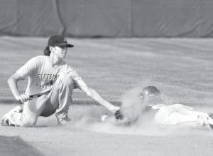 Archbold's Jeron Williams attempts to tag Tinora's Clay Fogt at second base but was too late, and Fogt was safe.– photo by Mary Huber