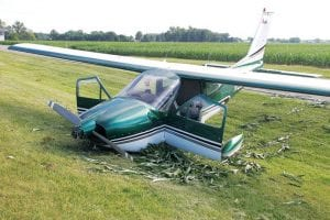 One man was still hospitalized on Monday after a plane crashed short of the runway at the Fulton County Airport, Wednesday, July 5. Preliminary information from the Federal Aviation Administration indicates the engine failed while the plane was on final approach.– photo by David Pugh