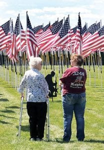 Loretta Cramer, Holgate, left, and her daughter, Marci Matthews, Defiance, stand in the Ohio Flags of Honor memorial, Saturday afternoon, July 29, at the Ridgeville American Legion. The family has a history of military service dating back to World War I, when Loretta's father, William Fuhrhop, served in the cavalry.– photo by David Pugh