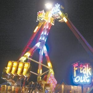 """The """"Freak Out"""" ride spins riders at a previous Fulton County Fair.– photo by Mary Huber"""