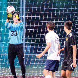 Blue Streak goalkeeper Caleb Wooley records a save in Archbold's 7-0 win over Pettisville.– photo by Mario Gomez