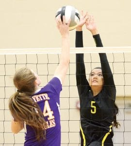 Pettisville's Sami Tilley (5) reaches to block a Fayette hit.– photo by Mario Gomez