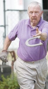 John Winzeler, Fayette, pitches a horseshoe in the Horseshoe Championship Tournament.– photo by Mary Huber