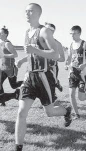 Hunter Beaverson, left, was third into the chute for the AHS boys team at the Archbold Cross Country Invitational, Saturday, Sept. 9. He finished 33rd overall. Dakota Stamm, right, was the second AHS girl to finish, placing seventh overall.– photos courtesy Sybil Richardson