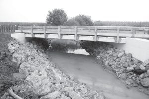 The Co. Rd. 25 bridge, built by Miller Brothers Construction, Archbold, for the Fulton County Engineer Office. The final project cost is estimated to come in about 1% over the original bid of about $305,000. The bridge is about 1,000 feet north of Co. Rd. D in German Township.– photo by David Pugh