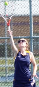 Callie Rohrs serves to an opponent earlier this season.– photo by Mary Huber