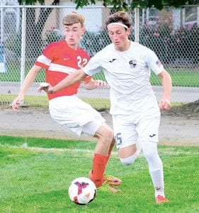 Archbold's Andrew Hogrefe, right, slips past a defender in Archbold's 9-1 NWOAL win over Wauseon, Thursday, Sept. 21. He scored two goals in the contest.– photo by Mario Gomez