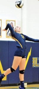 Kayla Boettger winds up for a jump serve. She was 12-12 with two aces against Evergreen.– photo by Mario Gomez