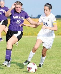 Naomi Rodriguez and a Swanton defender race for control of the ball, Thursday, Sept. 14. The Streaks defeated Wauseon last week to raise their NWOAL record to 3-0.– photo by Mario Gomez