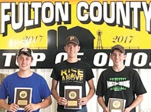Drake McKeever, Logan Rufenacht and Stetson Aeschliman, from left, placed first in the Fulton County 40-bale division of the Straw Stacking contest on Jr. Fair Day at the Fulton County Fair. They are junior members of the Pettisville FFA. Their time was 4 minutes, 20 seconds. They loaded the bales onto the truck, then Aeschliman drove over the obstacle course and then restacked them. They had no penalties.– courtesy photo