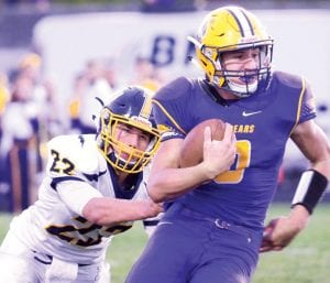 Archbold's Gavin Grime (22) tries to stop Bryan's Nate Miller from gaining yardage in their NWOAL battle, Friday, Sept. 29. The Streaks are 3-0 in the league after a 28-0 victory.– photo by Mario Gomez