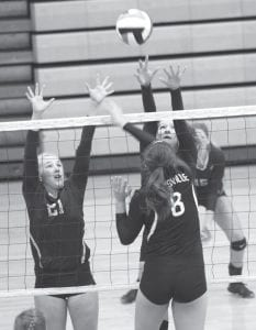 Archbold's Kaitlyn Beck (21) and Macey Rupp try to block a spike from Pettisville's Jess Youse (8) at the Streak SpikeTacular, Saturday, Sept. 30.– photo by Mary Huber