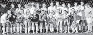 Members of the NWOAL champion Archbold girls soccer team are, front row from left: Madison Roth, Chloe Nofziger, Giulia Lee, Macey Peterson, Kamryn Hostetler, Brooke Kohler, Mikayla Welch, Regan Ramirez, Brittney Ramirez, Montana Stamm. Standing: James Kidder, head coach; Grace Mayer; Faith Wyse; Emie Peterson; Andi Peterson; Dakota Stamm; Leah Hall; Katie Short; Lily Krieger; Kennedy Miller; Delaney Garrow; Johanna Richardson; Naomi Rodriguez; Jennifer Kidder, assistant coach.– photo by Mario Gomez