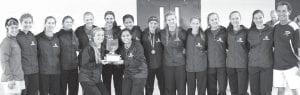 The AHS girls cross country team won its first NWOAL championship since 1999 on Saturday, Oct. 14. Holding the trophy: seniors Elizabeth Schmucker and Rosalyn Flores. Standing: Rachel Kinsman, head coach; Shylo Richardson; Gwynne Riley; Caitlyn Beldon; Kennedy Miller; Camryn Hudson; Brittney Ramirez; Kylie Sauder; Natalie Roth; Regan Ramirez; Dakota Stamm; Montana Stamm; Delaney Garrow; LaRoy Martinez, volunteer coach.– photo by Mary Huber