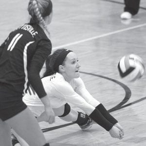 Pettisville libero Kyra Behnfeldt digs the ball in Pettisville's sectional final win over Cardinal Stritch.– photo by Mary Huber