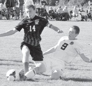 Detric Yoder (9) traps the ball with his foot in Pettisville's sectional semifinal with the Cardinals.– photo by Mario Gomez