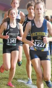 Archbold's Gwynne Riley, right, runs in front of Pettisville's Kate Stuber and Kelly Miller at the district meet, Saturday, Oct. 21, at Findlay.– photo by Beth Foor