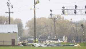 A severe thunderstorm passed through the area, Sunday, Nov. 5, damaging the ConAgra facility in Archbold. The photos, taken from Co. Rd. 24 looking east, show some of the damage. Top: Sheets of metal from the building became tangled in the Toledo Edison 69,000-volt transmission line, knocking it out of service. Below: Damage is evident along the roofline above the truck docks.– photos by Mary Huber