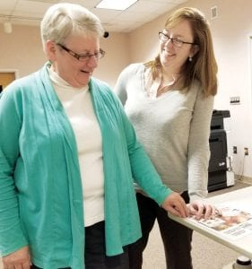 """Joyce Klingelsmith, left, retiring Archbold Community Library director, with Sonya Huser, her successor. Huser said she is not planning to make big changes to the library right away. """"I figure if there were needs for major changes, she (Klingelsmith) would have done them,"""" Huser said.– photo by David Pugh"""