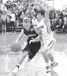 Eli Miller (3) pushes the ball up the court against the defensive pressure of Wauseon's Trent Armstrong.– photo by Mario Gomez
